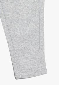 Puma - Tracksuit bottoms - light gray heather - 2