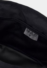 Nike Performance - Wash bag - black/enigma stone - 3