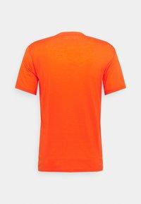 Mons Royale - ICON - Triko spotiskem - orange smash - 1