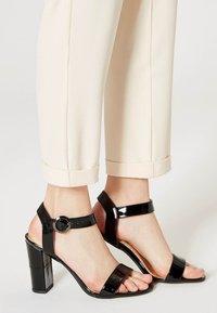 usha - Sandály na vysokém podpatku - black - 0