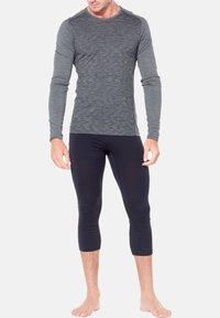 Icebreaker - 3/4 sportovní kalhoty - schwarz - 1