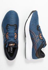 ASICS - EVORIDE - Neutral running shoes - grand shark/pure bronze - 1