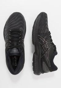 ASICS - GEL NIMBUS 22 - Neutral running shoes - black - 1