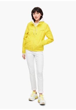 BLOUSON MIT INTEGRIERTER KAPUZE - Training jacket - yellow