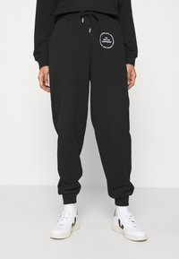Topshop - JOGGER WITH GRAPHIC - Tracksuit bottoms - black - 0