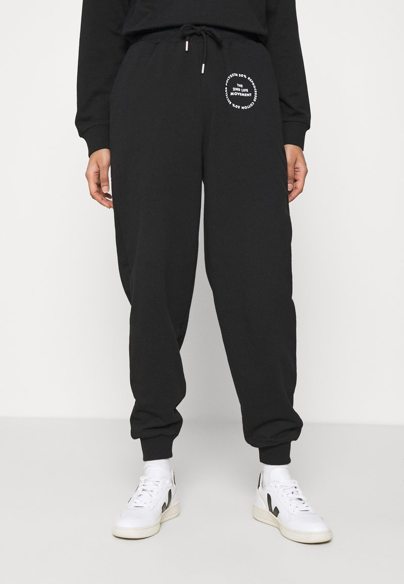 Topshop - JOGGER WITH GRAPHIC - Tracksuit bottoms - black