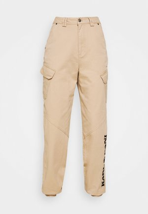 RETRO PANTS - Trousers - sand