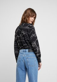 Selected Femme - SLFLOU DAWN - Slim fit jeans - dark blue denim - 3