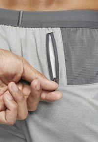 Nike Performance - Sports shorts - iron grey/iron grey/heather - 7