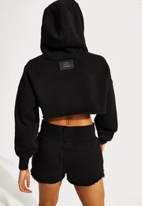 Sweaty Betty - SWEATY BETTY X HALLE BERRY NISI SUPER CROP HOODY - Sweatshirt - black - 2