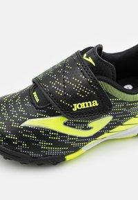 Joma - XPANDER JUNIOR UNISEX - Astro turf trainers - black/yellow - 5