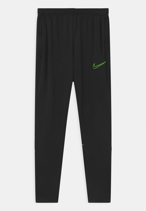UNISEX - Tracksuit bottoms - black/green strike