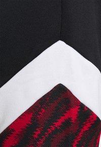 Puma - AC MAILAND ICONIC GRAPHIC TRACK PANTS - Club wear - tango red/black - 2