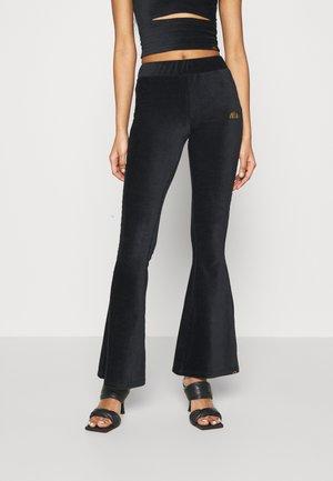 FLORIE - Trousers - black