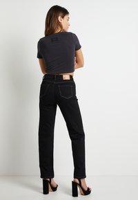 Pepe Jeans - DUA LIPA X PEPE JEANS - Straight leg jeans - black - 2