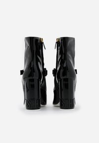 MOSCHINO - High heeled ankle boots - nero - 3