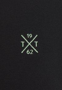 TOM TAILOR - UNDERCOLLAR WORDING - Polo shirt - black - 2