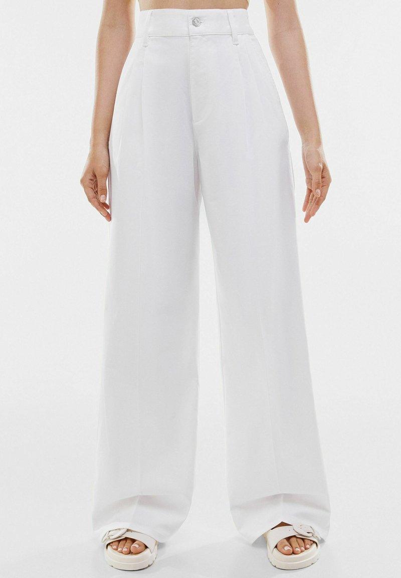 Bershka - Trousers - white
