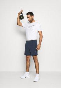 Nike Performance - FLEX - Pantalón corto de deporte - obsidian/black - 1