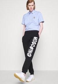 MOSCHINO - TROUSERS - Tracksuit bottoms - black - 6