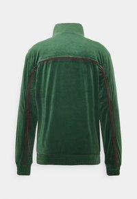 Karl Kani - SMALL SIGNATURE TRACK JACKET UNISEX - Training jacket - darkgreen - 1