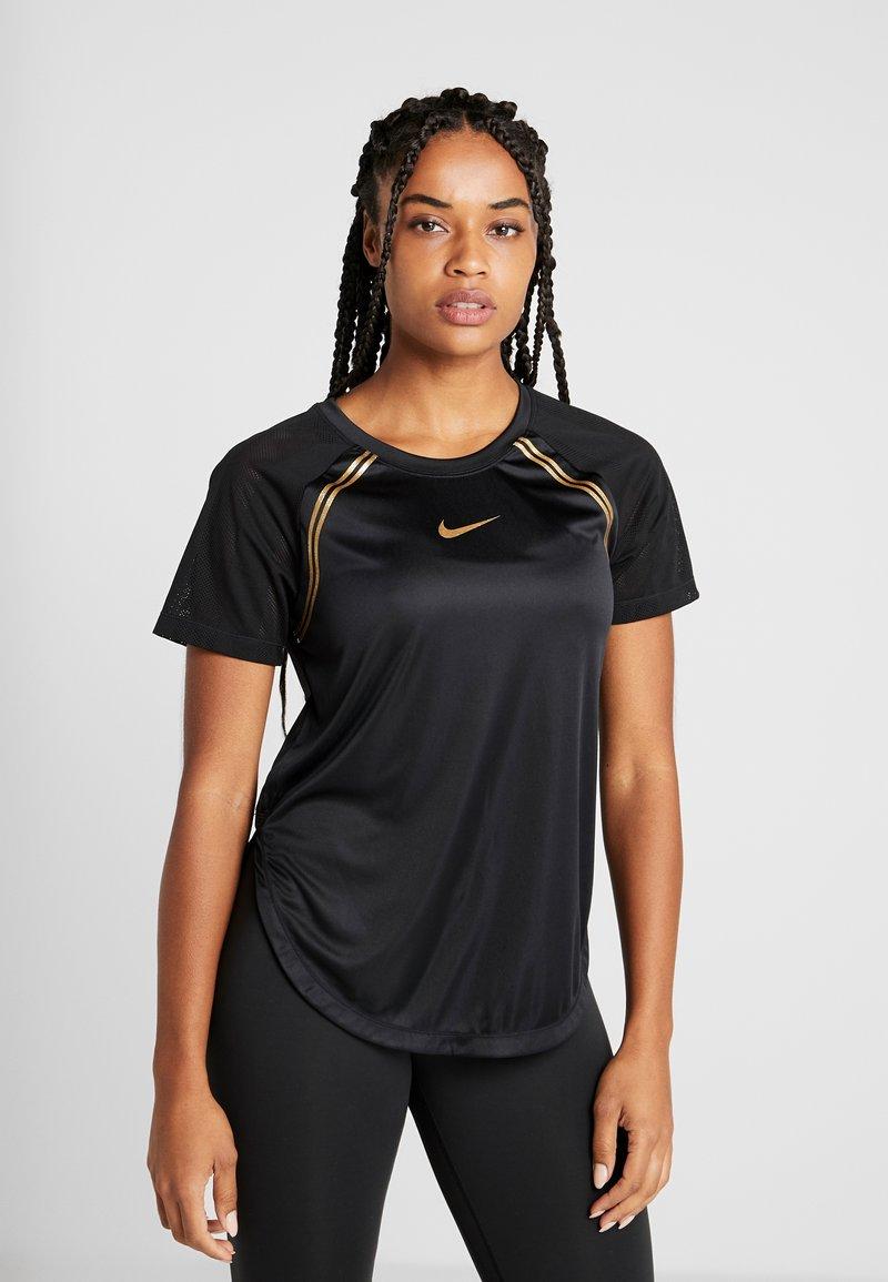 Nike Performance - TOP GLAM - T-shirt z nadrukiem - black/metallic gold