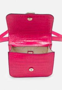 Guess - HANDBAG CORILY CONVERTIBLE XBODY FLAP - Across body bag - pink - 2