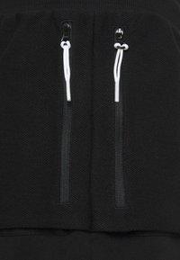 Puma - STANDBY SHORTS - Sports shorts - black - 2