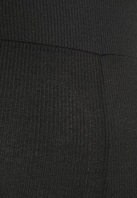 Missguided Petite - HALTER UNITARD - Jumpsuit - black - 2