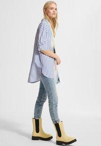 comma casual identity - Button-down blouse - powder blue stripes - 1