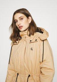 Calvin Klein Jeans - LONG UTILITY HOODED  - Winter coat - irish cream - 6