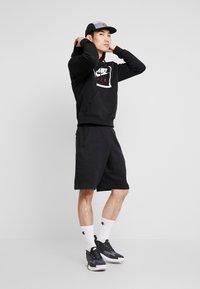 Nike Sportswear - HOODIE AIR - Jersey con capucha - black/white - 1