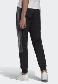 adidas Originals - BX-20 SWEAT JOGGERS - Tracksuit bottoms - black - 1