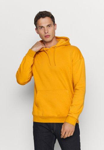 Luvtröja - yellow