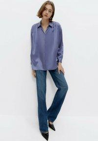 Uterqüe - Button-down blouse - light blue - 1