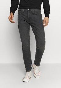 Levi's® - 502™ TAPER HI BALL - Jeans Tapered Fit - black denim - 0