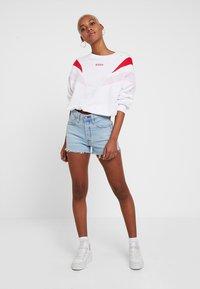 Levi's® - 501® HIGH RISE SHORT - Denim shorts - dibs tape - 1
