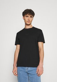 Calvin Klein Jeans - LOGO TEE UNISEX - Print T-shirt - black - 0