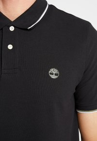 Timberland - TIPPED - Polo shirt - black - 5