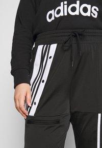 adidas Originals - CATHARI - Tracksuit bottoms - black - 3