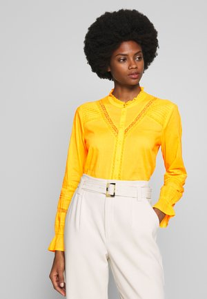 MANNA - Button-down blouse - spicy mustard