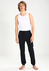 BOSS - MIX&MATCH - Pyjama bottoms - black - 1