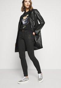 G-Star - LYNN MID SKINNY WMN - Jeans Skinny Fit - black radiant cobler - 3