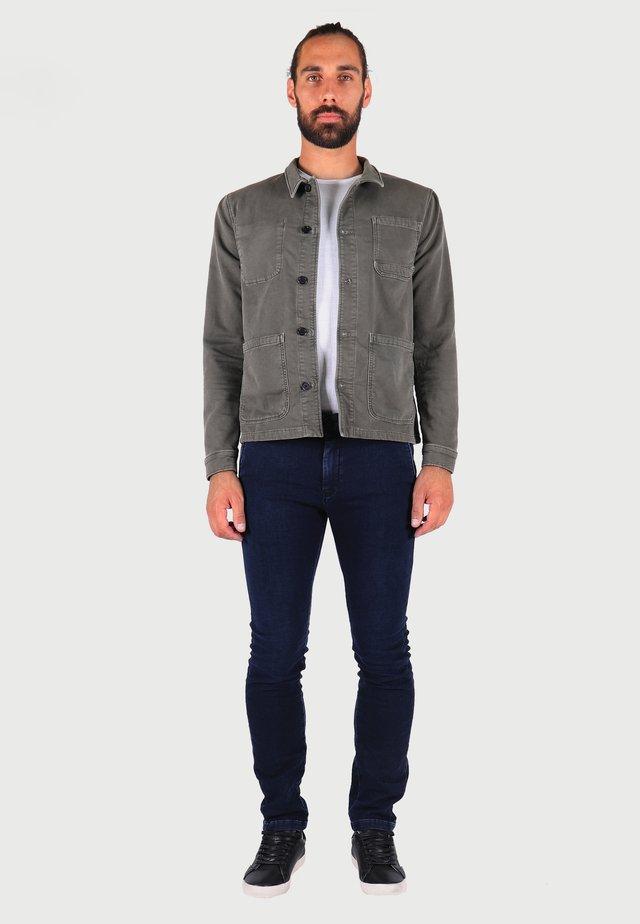 JOGG - Slim fit jeans - blue / black