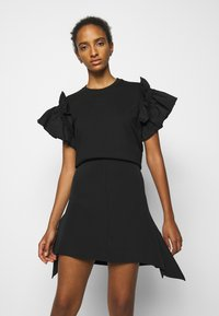 Victoria Victoria Beckham - FLOUNCE HEM SKIRT - A-line skirt - black - 3