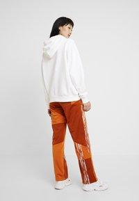 adidas Originals - DANIELLE CATHARI JOGGERS - Trousers - fox red - 3