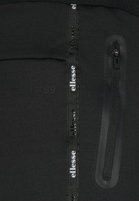 Ellesse - ROMFORD - Pantalones deportivos - black - 6