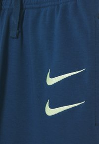 Nike Sportswear - Tracksuit bottoms - blue force/barely volt - 3