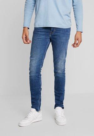 EVOLVE - Slim fit jeans - medium blue