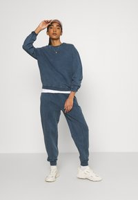 Topshop - ACID WASH JOGGER - Tracksuit bottoms - denim blue - 1